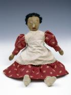 home-made cloth doll with red dress and white apron