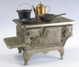 miniature metal cookstove with pots and pans