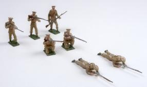 group of seven toy soldiers in various positions of fighting