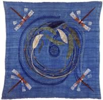 stylized embroidery on blue square of linen